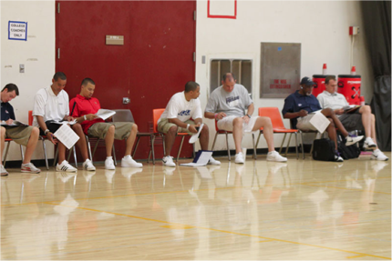 College recruiters at the Adidas Three Stripes tournament in LA scope out the courts for outstanding players.